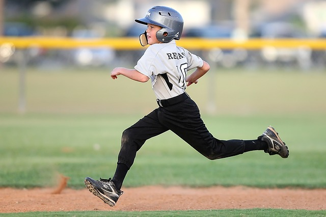 Young Baseball Player in Wide Cleats