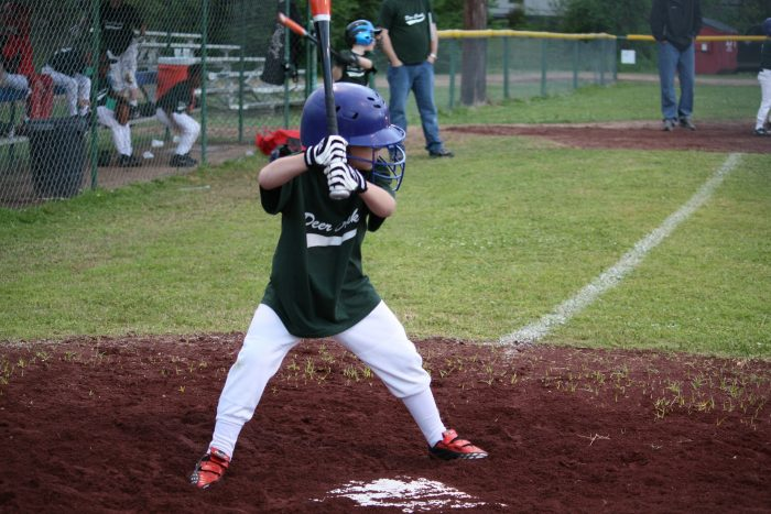 A youth baseball player getting ready to hit